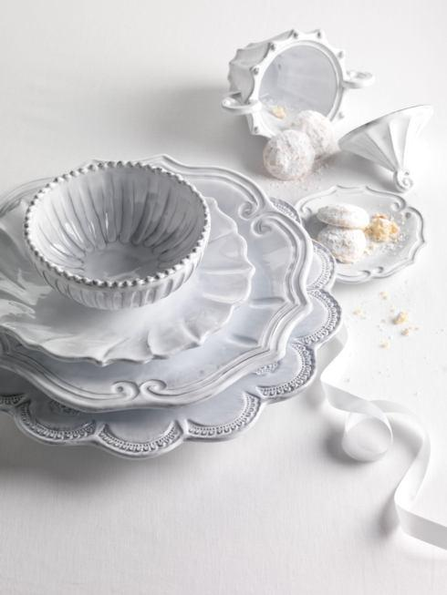 $180.00 Ruffle Four-Piece Place Setting