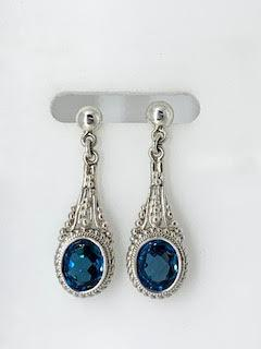 5.99tcw Blue Topaz Sterling Silver Leaf Earrings collection with 1 products