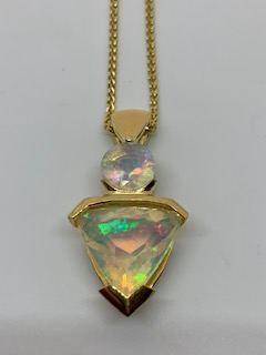 $1,975.00 2.48tcw Faceted Ethiopian Opal 18ky Pendant