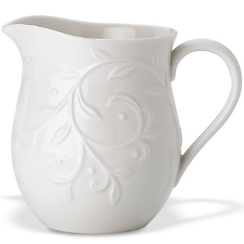 Opal Innocence Carved Creamer collection with 1 products