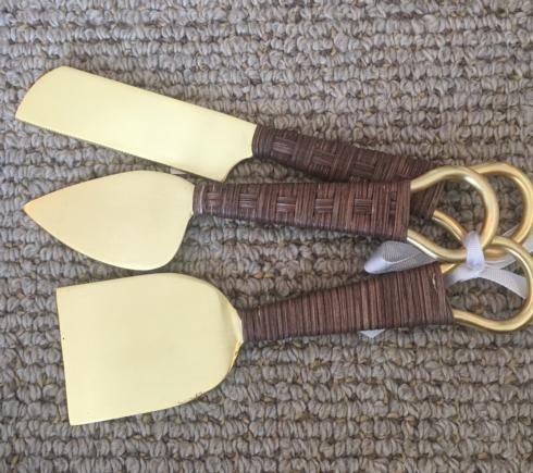 $48.00 Gold and rattan cheese knife set