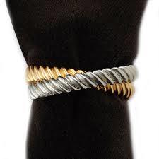 $120.00 Deco Twist Platinum + Gold Napkin Rings (set of 4)