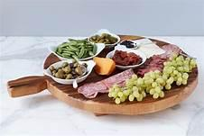 $225.00 Oversized Round Footed Serving Board