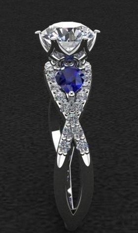 $1.00 Diamond Infinity with Sapphire Ring