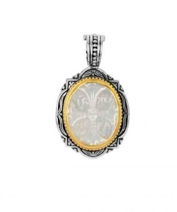 $1,580.00 Sterling Silver and 18kyg Carved Mother of Pearl Pendant