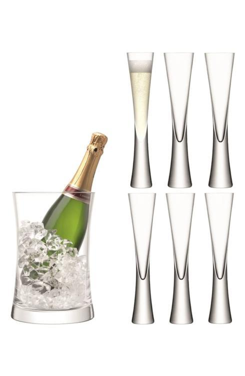 $200.00 Moya Champagne set consisting of 6 flutes and ice bucket.